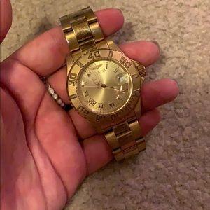 Gold Invicta watch